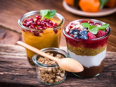 Colorful and healthy natural desserts in jar with chia.
