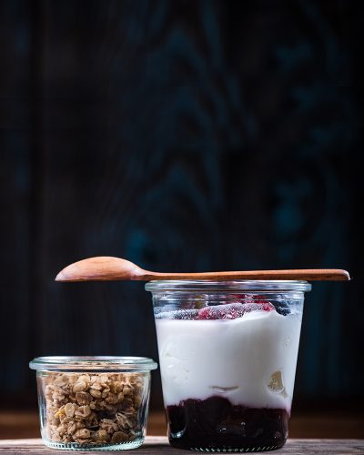 Natural yoghurt and raspberry dessert with granola.
